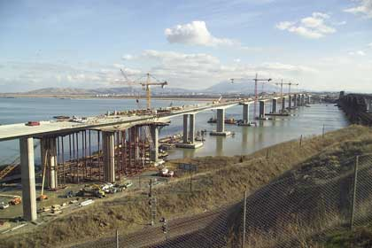 Benicia-Martinez Bridge: Light-weight, segmental, cast in place, with permeability reduction and earlier release of post tensioning.