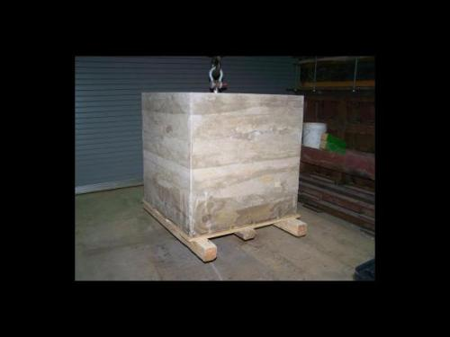 Geopolymer concrete block made with waste coal fly ash.